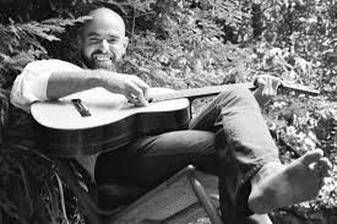 Shel Silverstein with a guitar